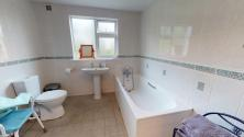 Large, fully tiled bathroom with walk-in shower
